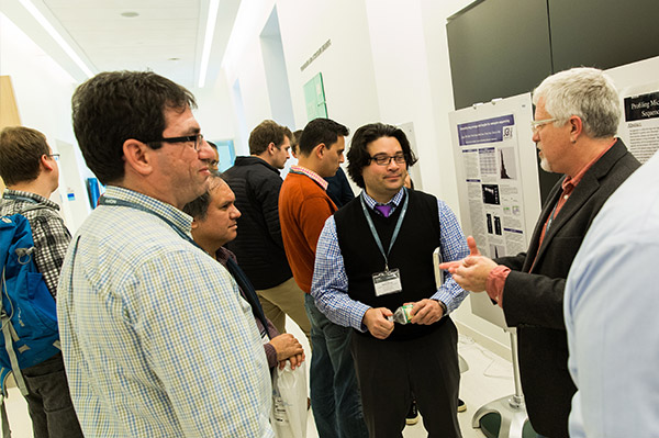 Community members in discussion at a Nanopore meeting